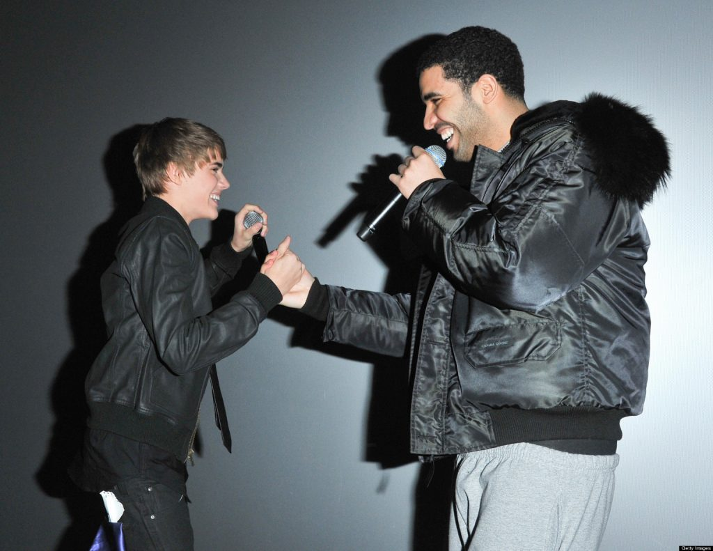 """Singer Justin Bieber and singer Drake attend the premiere for """"Never Say Never"""" at the AMC Yonge & Dundas 24 theater on February 1, 2011 in Toronto, Canada."""
